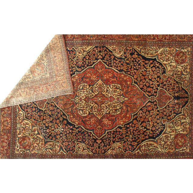 A hand-knotted antique Sarouk Farahan rug. The piece was made from hand-spun lamb's wool and all natural dyes. Circa 1880.