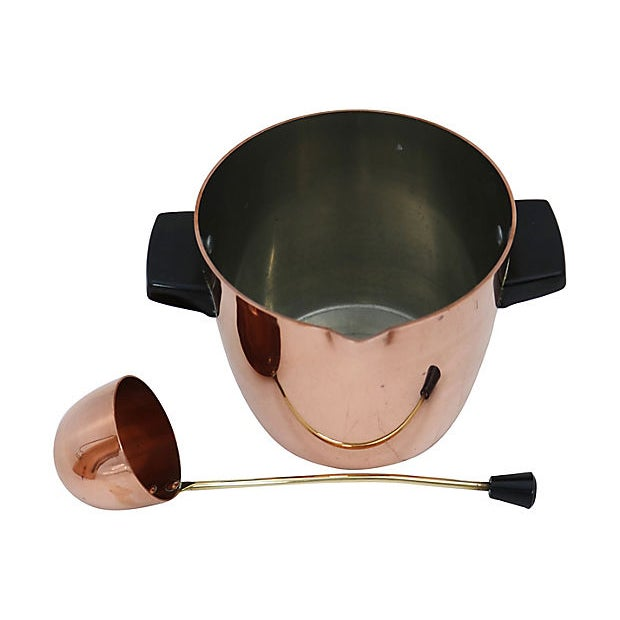 """English copper ice bucket and ladle. Dimensions: ice bucket, 8""""L x 6.25""""W x 5""""H; ladle, 9.25""""W x 2.5""""W x 2.75""""H. No..."""