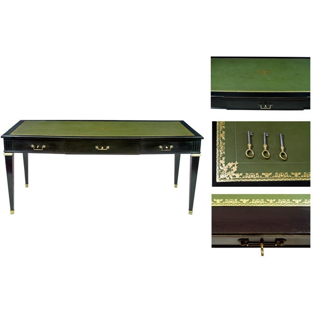 A Louis XVI Style Gilt-Bronze Mounted Black Lacquered and Tooled Green Leather Top Writing Table. Circa 20th Century.