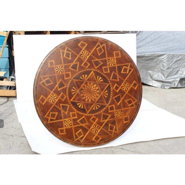 Really a nice piece late 20 century. Nice inlay massive size would be fantastic under a chandelier with orchids