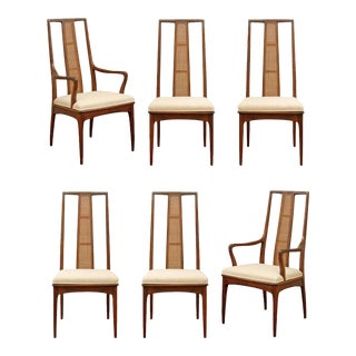 Elegant Set of Six Walnut and Cane Dining Chairs by John Stuart For Sale