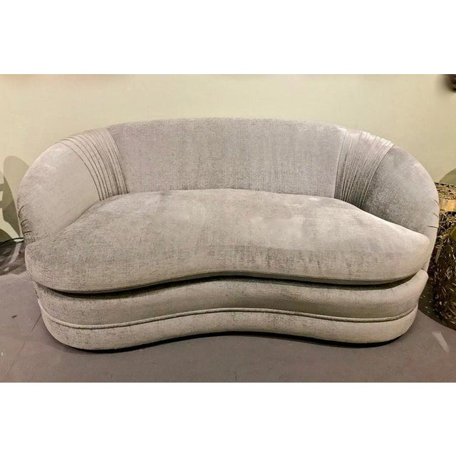 This is a beautifully fabricated curved small sofa. The top quality blue-gray chenille upholstery is in pristine condition...