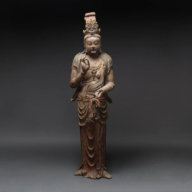 Pair of sculptural standing avalokitesvara bodhisattvas, the high mukuta crowns, each bejewelled with either a small...
