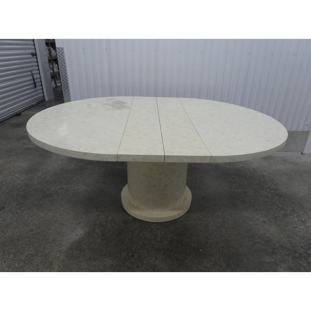 Enrique Garcel tessellated bone dining table w 2 leaves. Sold as found in good condition without damage. There is a...