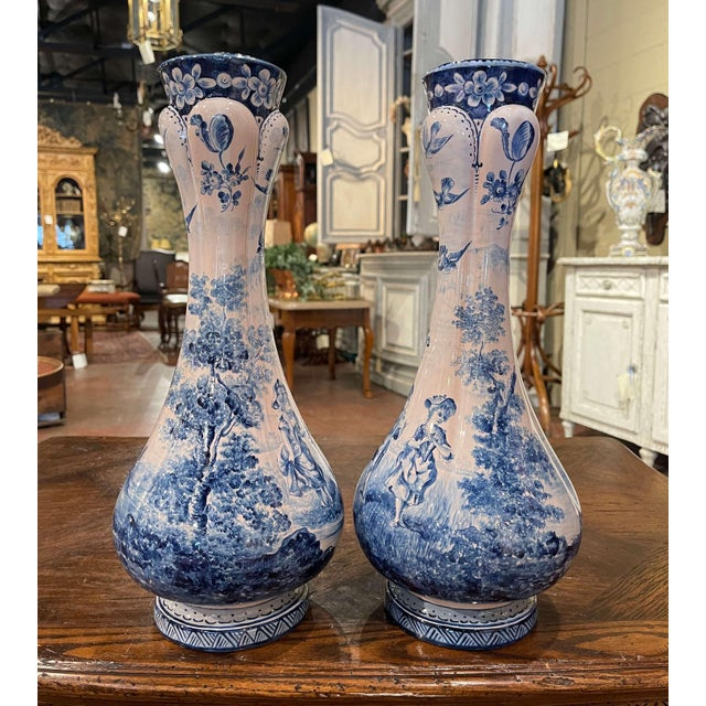 Decorate a shelf or console table with this elegant pair of antique faience vases. Crafted in France circa 1880, both...