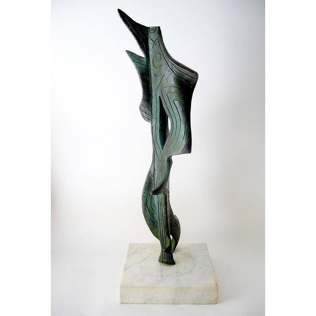 Large-scale sculpture, resembling an abstract underwater sea creature, in the style of master artist Joan Miró. Materials...