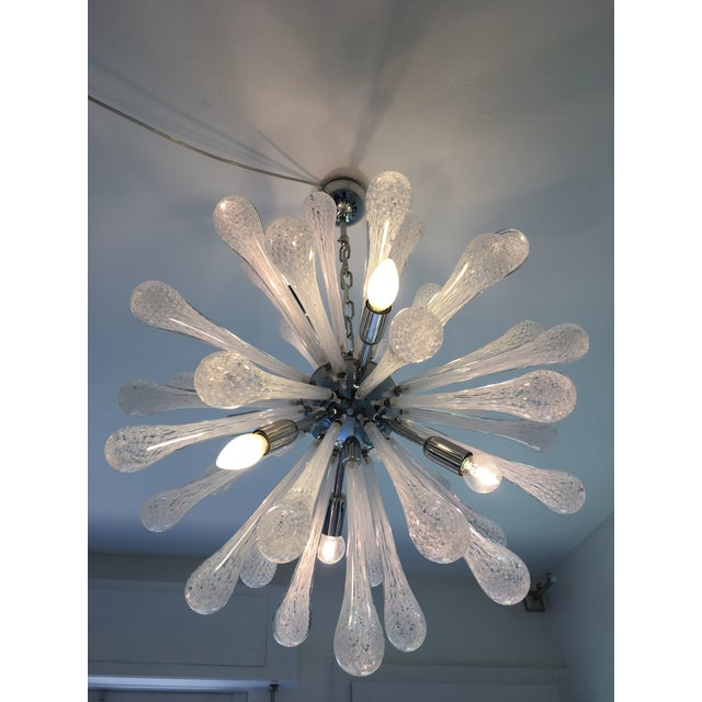 Murano glass sputnik chandelier featuring white and transparent Murano drops with a chrome metal frame. Spare parts...