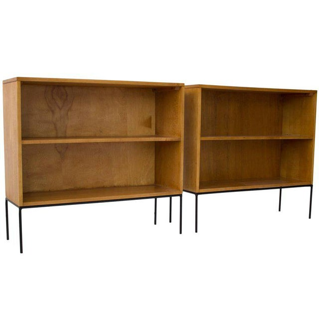 Excelllent pair of Paul McCobb solid Maple bookcases on painted iron bases.