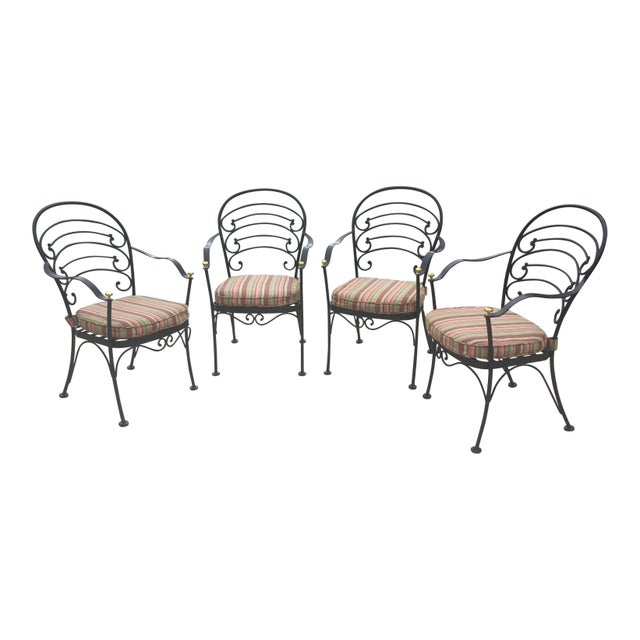 Very nice black iron Woodard patio set. Chairs have arched back with scroll design curved arms with end with a brass knob...