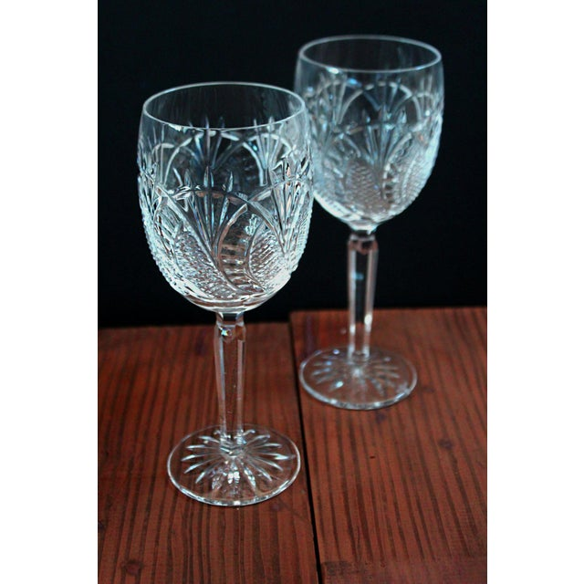 One of Waterford Crystals finest patterns. The glasses have angles that will keep you looking for the rainbow. Both...