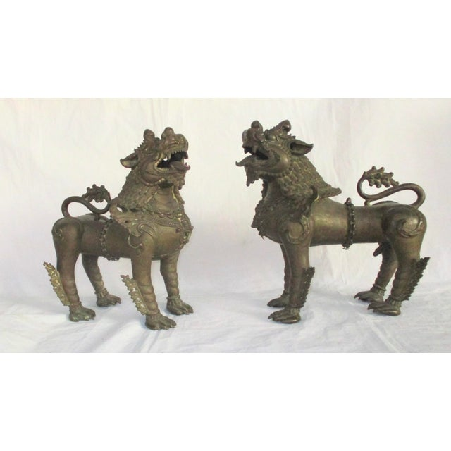 Antique bronze Buddhist lions from Nepal circa mid-late 18th century. Lost wax bronze lions cast in two sections,...