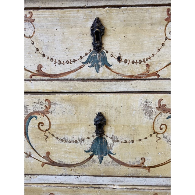 Beautiful 19th C Italian three drawer commode, with hand painted designs. This lovely piece is all original with a faux...