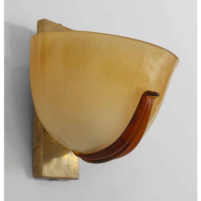 Pair of Italian 1940s Venetian Murano gold dusted glass wall sconces in the form of a half-round bowl secured by a brass...