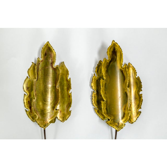 This gorgeous pair of brass sconces attributed to Holm-Sorensen & Pedersen of Denmark were made in the 1950's. They are...