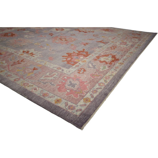 Polished and playful, this hand knotted wool Turkish Oushak area rug features a contemporary style with modern colors and...