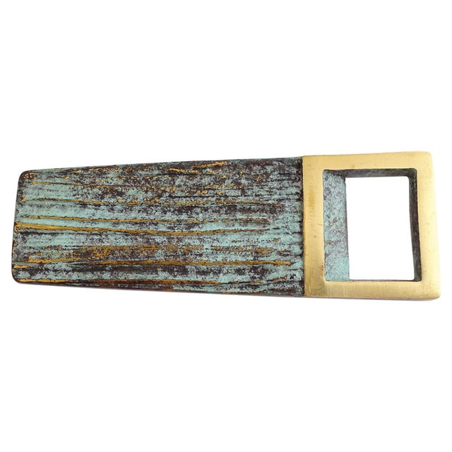 """Patinated brass letter opener with geometric """"stitch"""" border."""