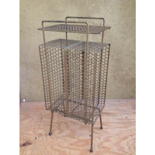 This is an amazing piece of history. A great metal album/magazine/telephone stand table that has the much loved Mid-...