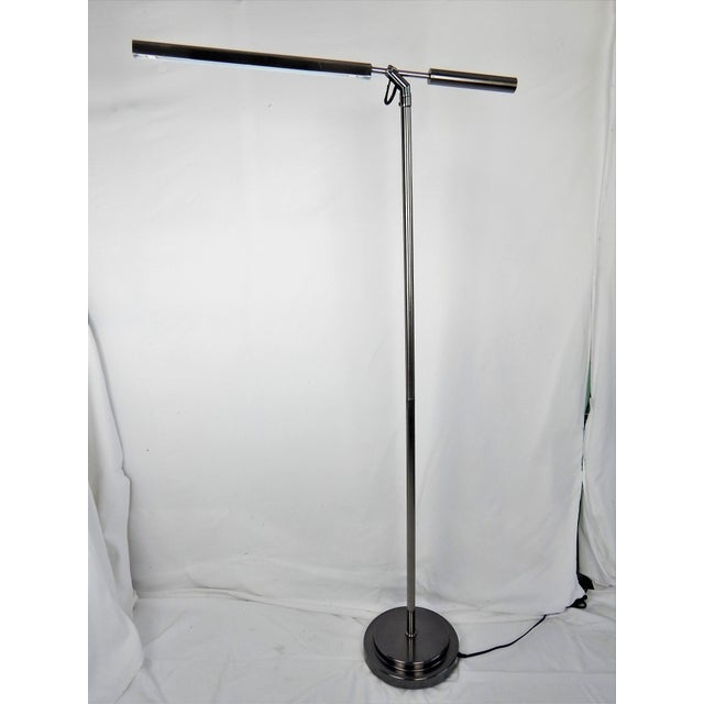 Sleek, sculptural brushed fluorescent brushed-chrome floor lamp. Original wiring in working order features In-line step...
