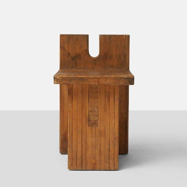 A side chair in solid pine wood designed by Lina Bo Bardi and created for the center SESC Pompeia in Sao Paulo. Brazil.