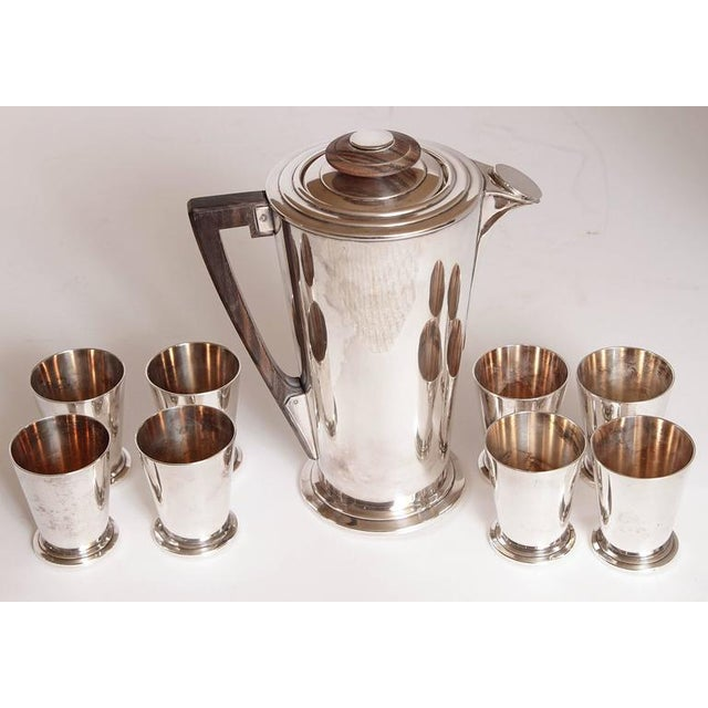Primo quality thick silver plate and amboyna / Macassar wood beverage set. circa 1927 patented design, originally for the...