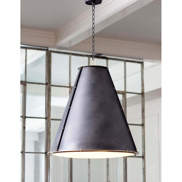 A blackened natural brass cone silhouette is trimmed with a natural brass ring on the top and bottom of the French Maid...