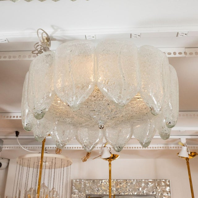 """Flush mount ceiling fixture composed of icy glass """"drip"""" fragments."""