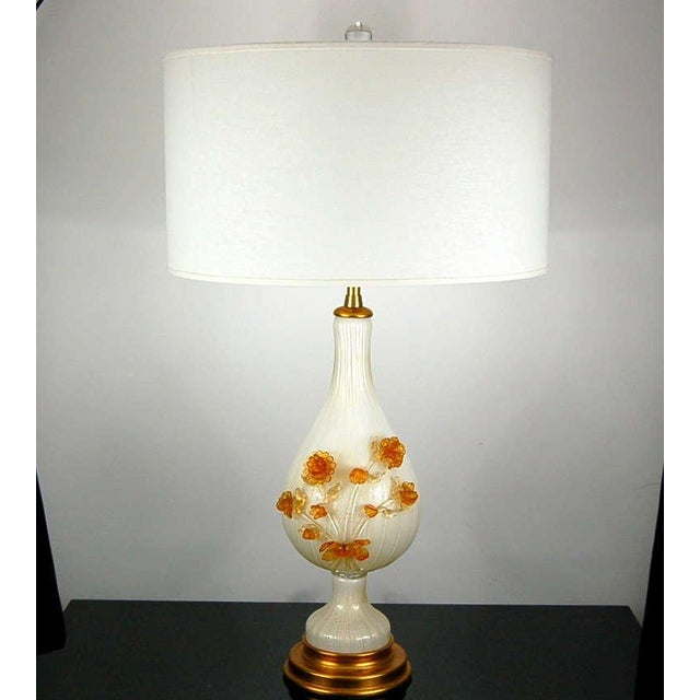 A glorious bouquet of Venetian glass flowers adorn these vintage Murano GOLD filled WHITE glass table lamps, by The Marbro...