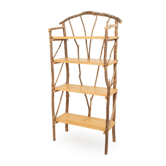 Rustic Adirondack 20th century etagere (shelving unit) with twig and branch spindle design having an arch top with four...