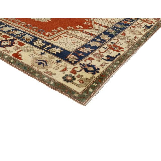 Vintage Turkish Oushak rug with Mid-Century Modern style. Features a center medallion and two columns centered on an...