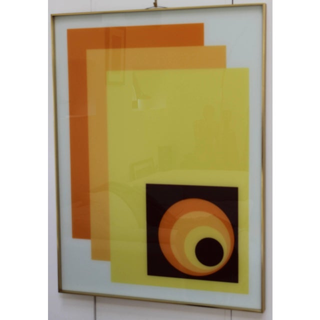1970s modern Op wall art on glass by Turner with brass frame. This piece can be hung vertically or horizontally.