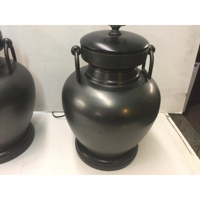 Pair of fantastic urn form bronze finish table lamps by pottery barn. In excellent condition. Includes finials but no...