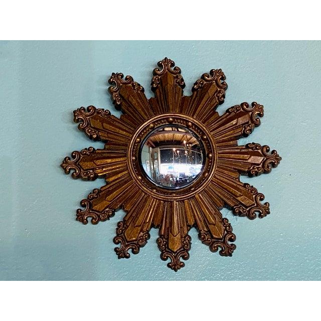 A wonderful small mid century convex starburst mirror. Circa 1970