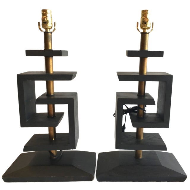 Pair of Mid Century Modern table lamps attributed to James Mont. The rhythmic, Greek key, geometric design is executed in...