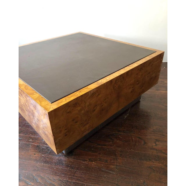 A beautiful cubed, book matched burl wood coffee table with incredible graining and a Naugahyde on the surface of the...