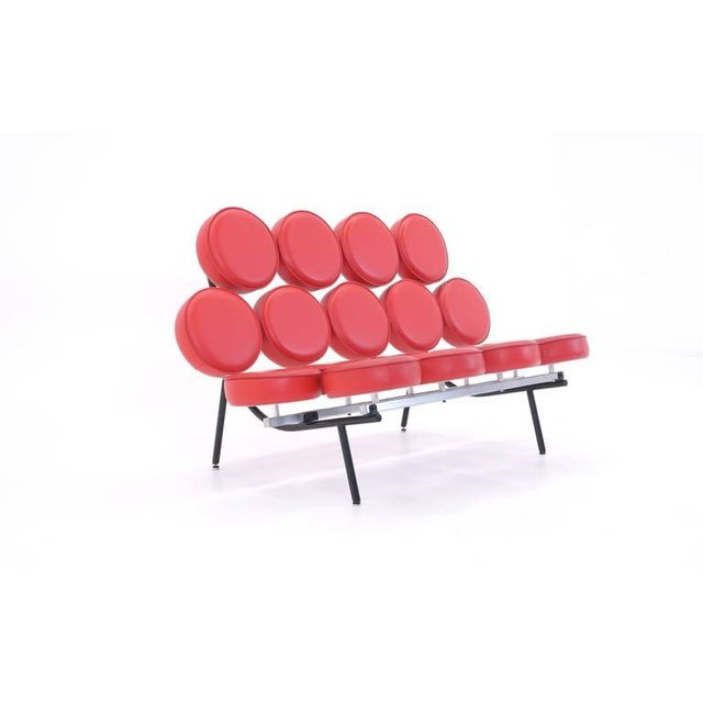 Designed by Irving Harper for the Nelson office, this is an early reissue of the iconic Marshmallow sofa. Red leather.