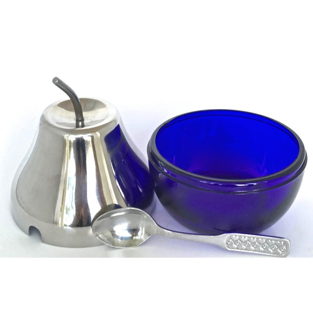 Here is a very unique pear shaped jelly pot with a spoon. The bottom part is Cobalt blue glass. The top and spoon are metal.