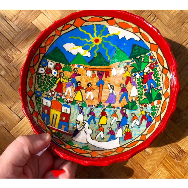 Bright and bold Mexican folk art. Hand painted with glitter accents and then lacquered over for durability. This clay is...