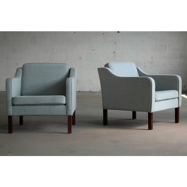 Very elegant pair of lounge chairs in the style of Borge Mogensen's Model 2421. These chairs by Mogens Hansen were...