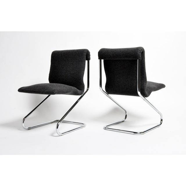 These stylish chrome chairs exemplify the spirit of French post-war modernism. They are sleekly comfortable and have...