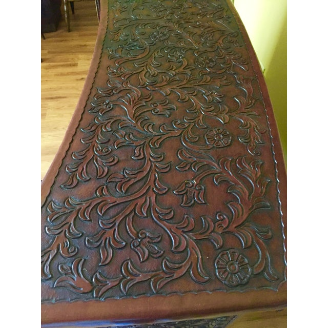 Having lived in Peru,my parents bought a lot of hand tooled,handmade leather furniture from the locals there. A lot of...