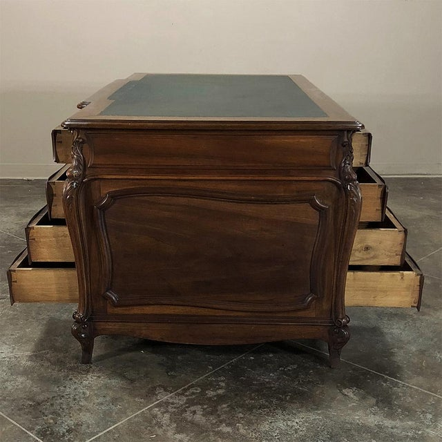 19th Century Louis XIV Walnut Partner's Desk will make an executive's office the talk of the company! Featuring boldly...