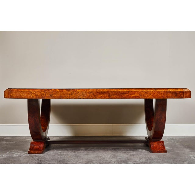An early 20th century French Colonial Art Deco dining table from Vietnam. Made of rosewood, with burled wood legs and...