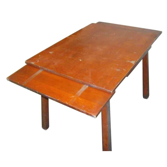 This adjustable table is a restoration piece. It needs work on sides and is hard to close.