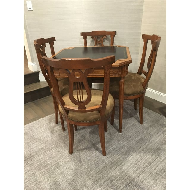 Antique game table set. Top of table covered in black leather. Set of 4 chairs covered in coffee colored ultra suede with...
