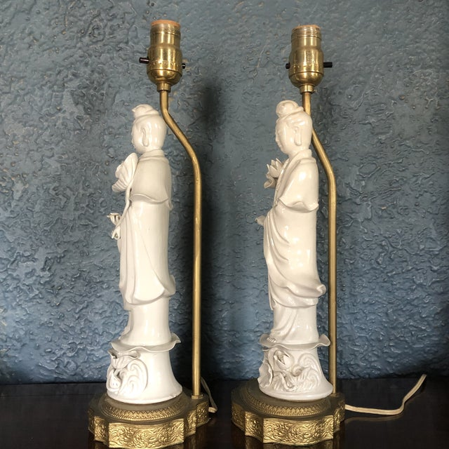 Vintage pair of Blanc de Chine porcelain Asian goddess lamps. One of the lamps has a couple of small imperfections on the...