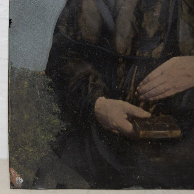 19th Century Portrait of a Woman on Tin A stern faced woman sits with her hand over her bible. A fine oil portrait on tin....