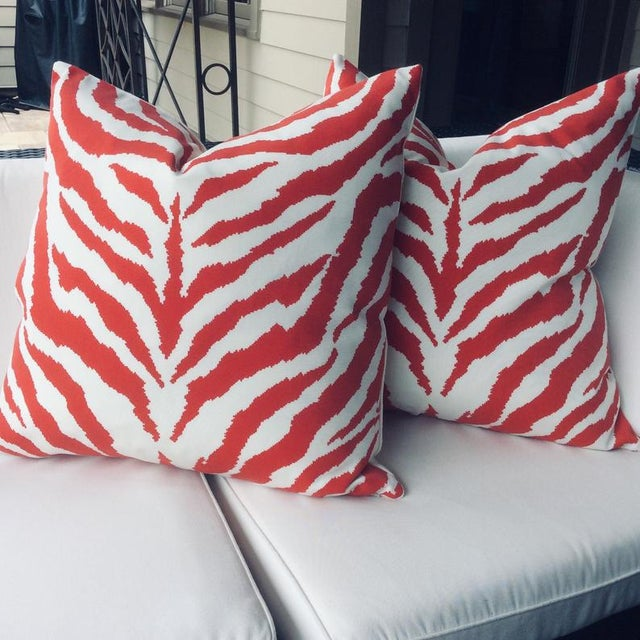 """Featured is a bold """"fire engine"""" red and white zebra stripe pair of pillows made from Clarence House fabric. Fabric is an..."""