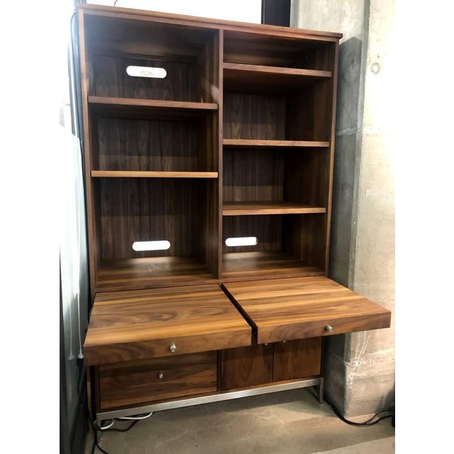 Beautiful custom Room and Board solid walnut cabinet with six walnut inserts. Highly functional with adjustable shelving...