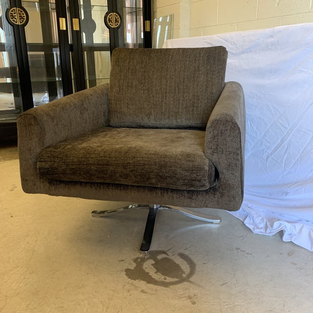 Beautifully reupholstered in a dark green chenille like fabric. Nice thick cushions and foam. Very comfortable. Chrome...