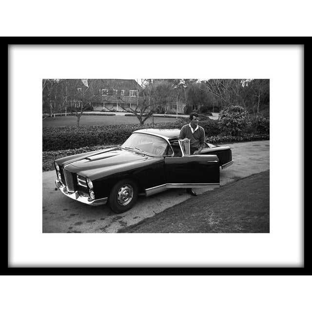"""Dean Martin and his Facel Vega HK500 in the driveway of his Beverly Hills home on Mountain Drive, 1961. 11"""" x 14"""" silver..."""